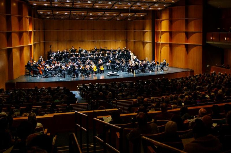 A photo of the orchestra on stage.