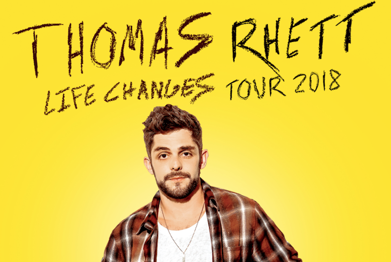 SInger Thomas Rhett standing in front of a yellow background.